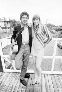 NEWPORT, RI - JULY 1967: Singer/songwriters Leonard Cohen and Joni Mitchell meet backstage before separately performing at the Newport Folk Festival in July 1967 in Newport, Rhode Island. (Photo by David Gahr/Getty Images)